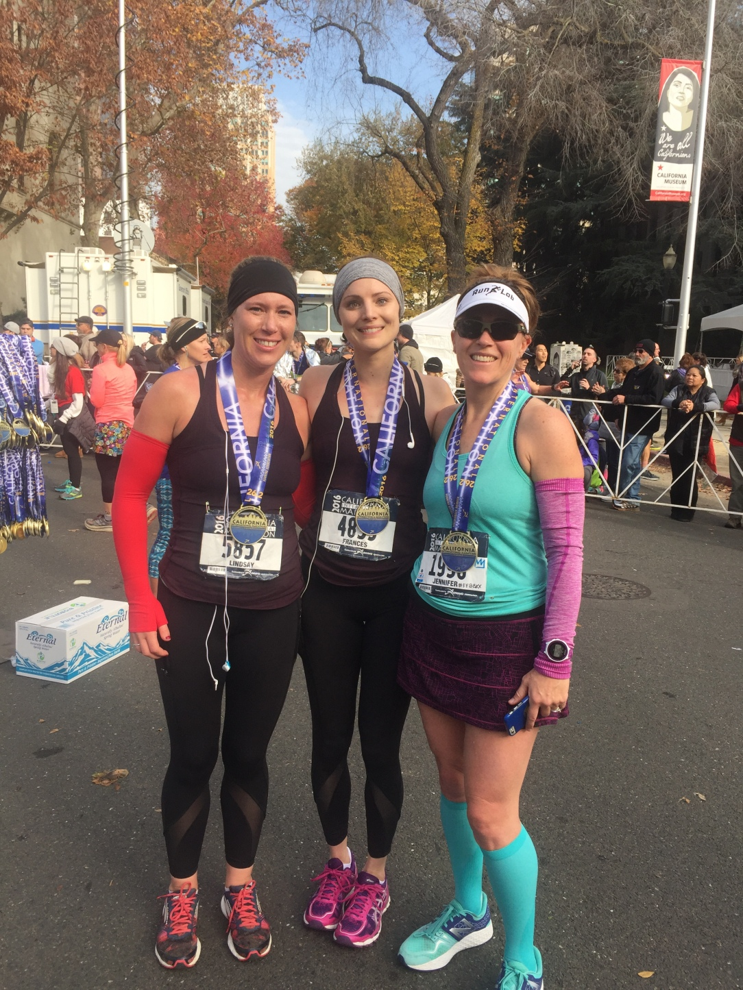 Finish line photo with our new running friend, Jen